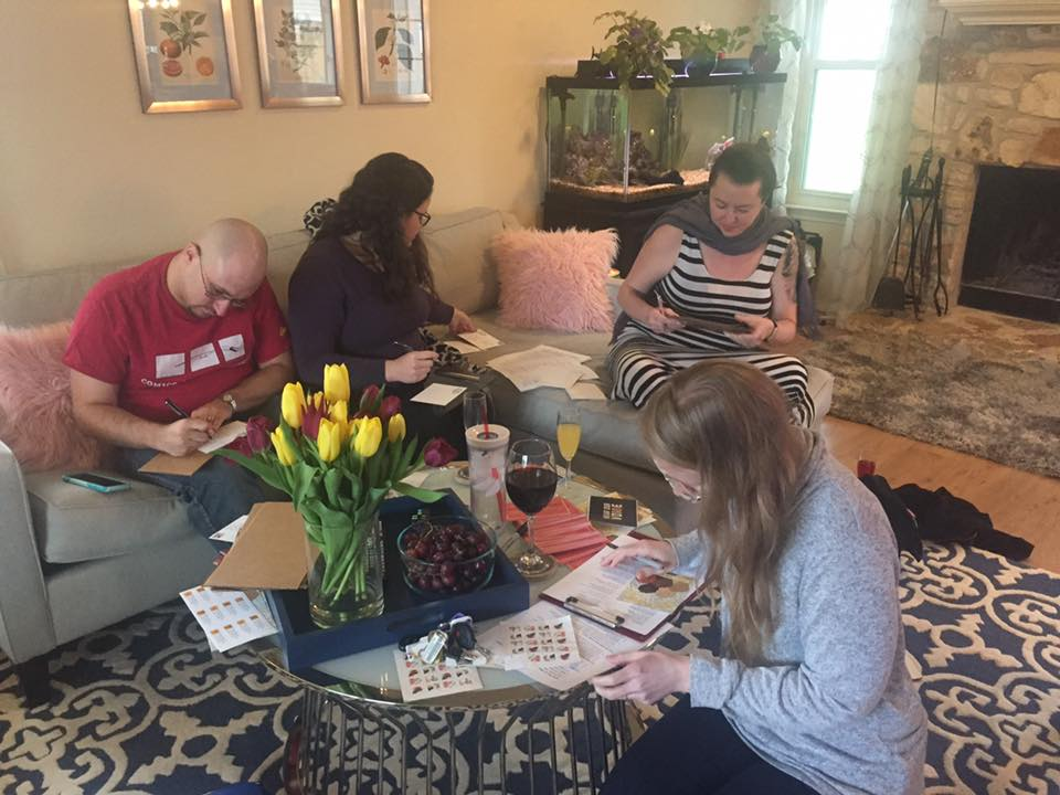 Friends writing postcards to their elected officials during a postcard party