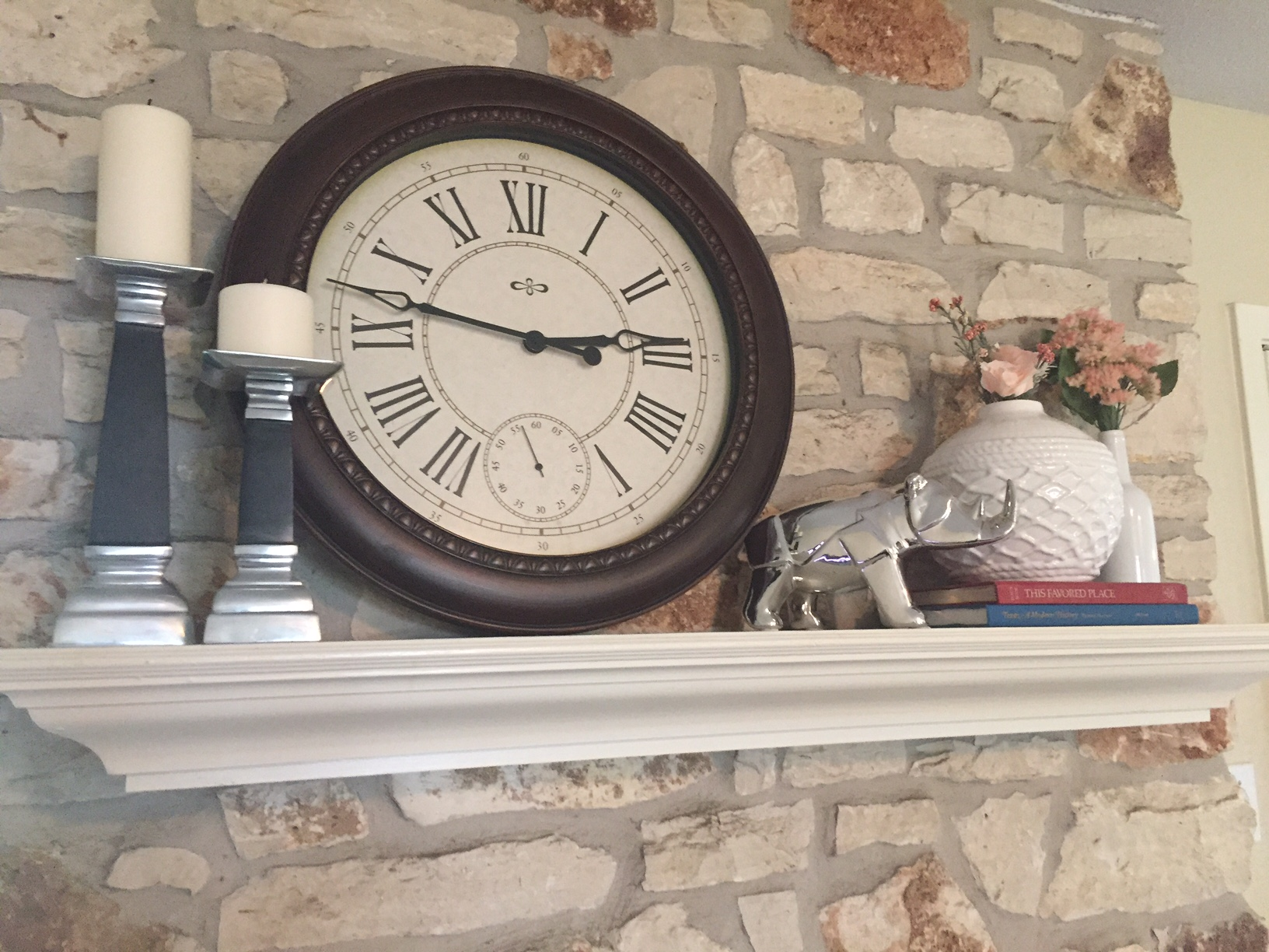 A stone mantle styled with found objects