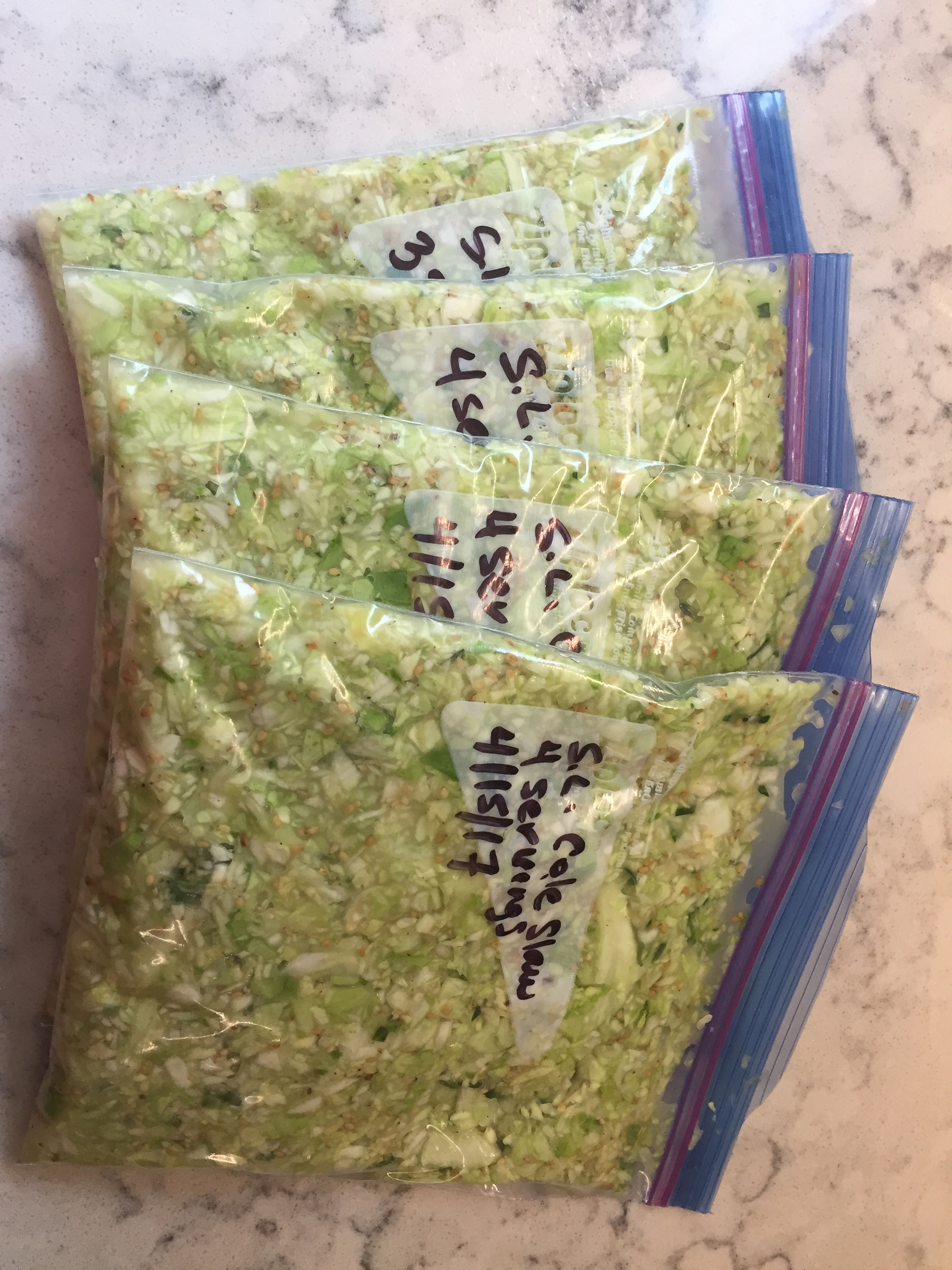 Four bags of freezer cole slaw