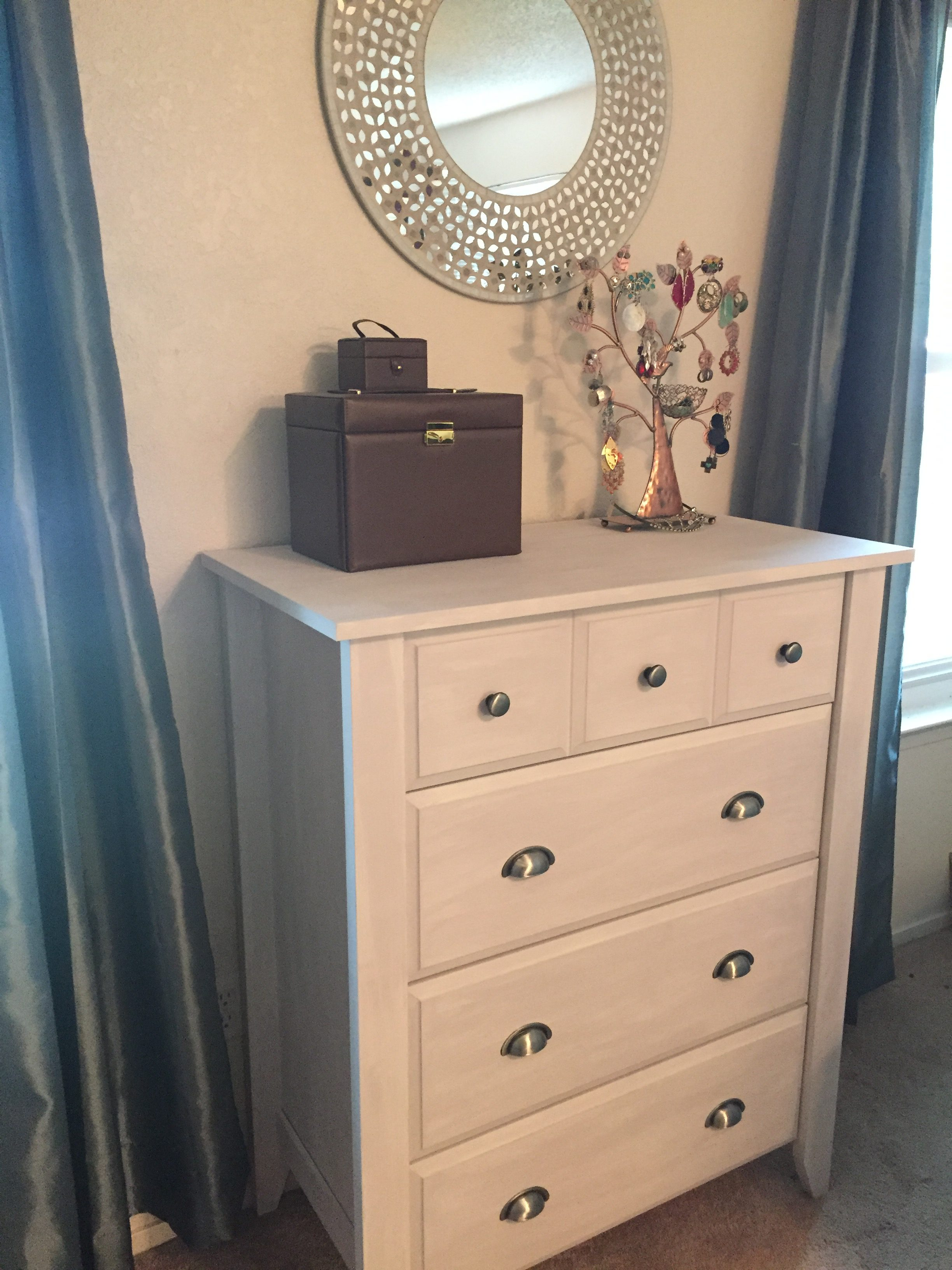 A dry-brush painted dresser, earring tree, and mosaic mirror come together to a bedroom jewelry nook instead of always being all over the house.